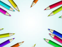 Colour pencils lying over light blue background. With place for text Royalty Free Stock Photo