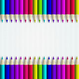 Colour pencils lying on white tablecloth Royalty Free Stock Photo