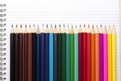 Colour pencils and Notepad book Royalty Free Stock Image