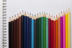 Colour pencils and Notepad book Royalty Free Stock Photos