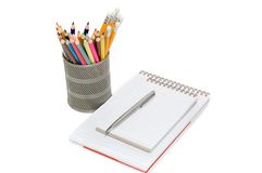 Colour pencils and notepads. Iolated on white Royalty Free Stock Photography