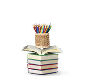Colour pencils open book Royalty Free Stock Images