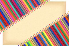 Colour pencils and paper isolated on white Stock Images