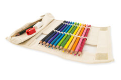 Colour pencils in pocket bag fabric Royalty Free Stock Photos