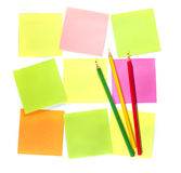 Colour pencils and postit  for reminder note. On the white background Royalty Free Stock Images