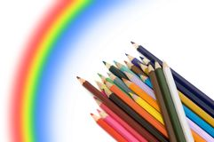 Colour pencils and rainbow stock images