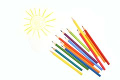 Colour pencils under the drawn sun. Isolated. Colour bright pencils, yellow drawn sun, childhood, art, picture, creativity and fun Stock Photos