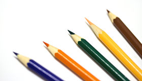 Colour pencils on white background. Close up royalty free stock image
