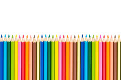 Colour pencils on white background. Close up royalty free stock photography