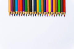 Colour pencils on white background close up.  royalty free stock photography