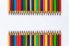 Colour pencils on white background close up.  stock photo