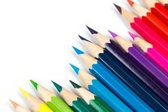 Colour pencils on white background, top view royalty free stock photo