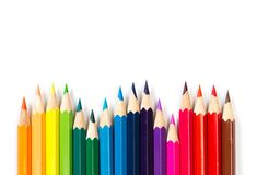Colour pencils on white background, top view stock photography
