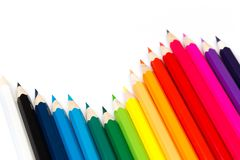 Colour pencils on white background, top view royalty free stock image