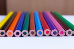 Colour pencils on white paper close up royalty free stock photography