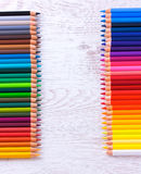 Colour pencils on white table. Colour pencils on a white table background Stock Photos
