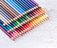 Colour pencils on white table Royalty Free Stock Photos