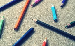Colour pencils on wood background Stock Image