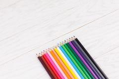 Colour pencils on wooden background. Colour pencils on white wooden background Royalty Free Stock Image