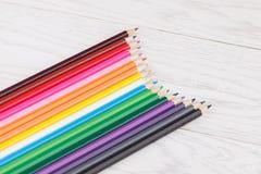 Colour pencils on wooden background. Colour pencils on white wooden background Stock Photo