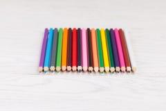 Colour pencils on wooden background. Colour pencils on white wooden background Royalty Free Stock Photos
