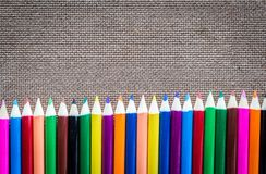Colour pencils on wooden board. Empty space for text Royalty Free Stock Image