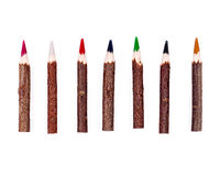 Colour pencils with wooden twigs Royalty Free Stock Photo