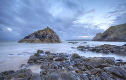 Colour poking through. Three Cliffs Bay, Gower, Swansea, South Wales UK Royalty Free Stock Photo