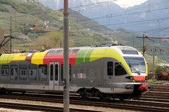 Colour rail in Bolzano FLIRT ETR 170. Südtirol Bahn 4-car Stadler Flirt dual voltage EMU just arrived at Bolzano from Merano, which is a very scenic line Stock Photography