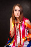 Colour ribbons. The girl is wound by colour ribbons Stock Photography