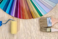 Colour samples with brushes on bamboo mat stock image