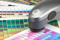 Colour Scanner. The colour scanner is use to scan colour and ink density in order to create a printer profile for colour matching from monitor, printer and media Royalty Free Stock Images