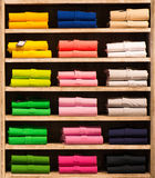 Colour shirts at shelf in shop Royalty Free Stock Photo