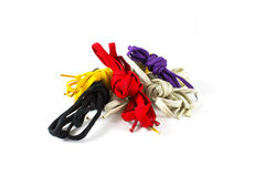 Colour shoelace. White, purple, black, yellow, on white background stock image