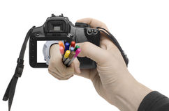 Colour Shot. A hand appears out of the display of a digital camera Stock Photo