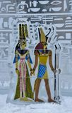 Colour silhouettes of ancient Egyptian figures imprinted in ice Royalty Free Stock Images