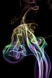 The colour smoke. Is photographed on a black background Royalty Free Stock Photos