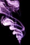 Colour smoke. On a black background Royalty Free Stock Photos