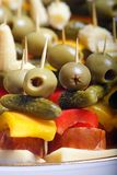 Colour snacks. - Party food. Colour snacks made up of olive, little cucumber, pepper, sausage and cheese. - Party food Royalty Free Stock Image