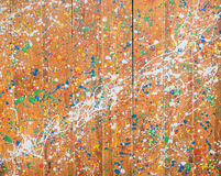 Colour splatter on wood wall Royalty Free Stock Photography