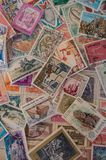 Colour stamps as a tall photo. Old stamps photographed in a tall format. Could be used as a background or online advert Stock Images