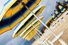 Colour sunshades on a empty beach. In southern Italy Royalty Free Stock Image