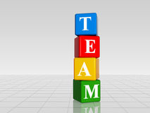 Colour team with reflection. 3d colour boxes with white letters with text team with reflection Royalty Free Stock Photo