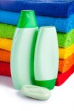 Colour terry towels combined by pile and  shampoo Royalty Free Stock Photography