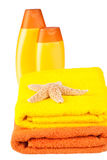 Colour terry towels, shampoo, soap and starfish Stock Photos