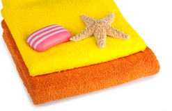 Colour terry towels, soap and starfish Royalty Free Stock Photo
