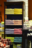 Colour towel stacked neatly on the shelf in fashion shop Stock Images