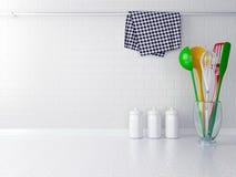 Colour utensils. Colour utensils on the white worktop. Kitchen interior Stock Photo
