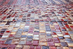 Colour wet cobblestone road in rainy weather Royalty Free Stock Images