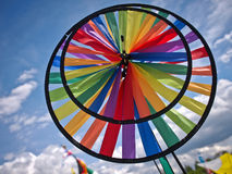 Colour wheel. Wind operated colour wheel beneath a blue sky Stock Images